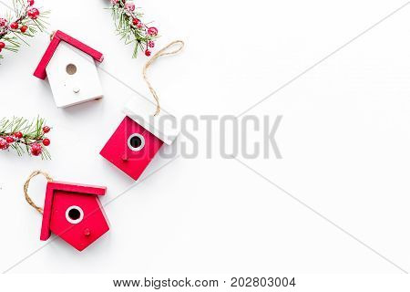 house toys to decorate christmas tree for new year celebration with fur tree branches on white table background top veiw mockup