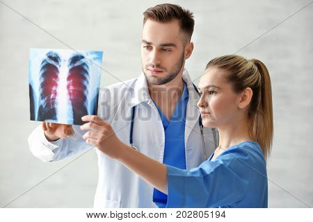 Doctors with x-ray image at hospital. Lung cancer concept