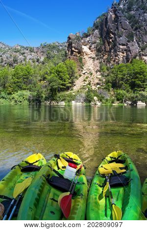 some kayaks stranded at the Ebro River as it passes through Benifallet, Spain