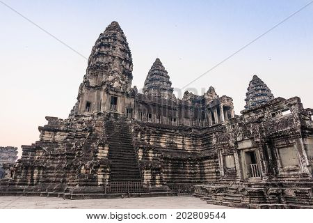 Stairs leading to upper galleries and towers of main Temple Mountain of ancient temple complex Angkor Wat in Siem Reap, Cambodia. Angkor Wat is a popular tourist attraction.