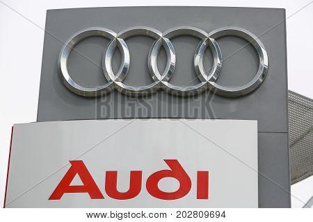 HUETTENBERG GERMANY JULY 2017: AUDI logo on a showroom facade. AUDI is a German automobile manufacturer based in Ingolstadt BADEN-WÜRTTEMBERG Germany.