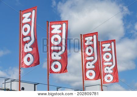 WETZLAR GERMANY JUNE 2017: ORION flags against sky at the ORION Store.. ORION is a German Sex Shop chain based in Flensburg