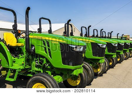 Indianapolis - Circa August 2017: 5045E Tractors at a John Deere Dealership. Deere manufactures agricultural construction and forestry machinery IV