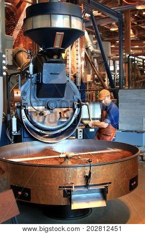 Fresh coffee being roasted in a modern machine at Starbucks reserve roastery in Seattle Washington. The picture was taken in Seattle Washington USA on Aug 01 2017