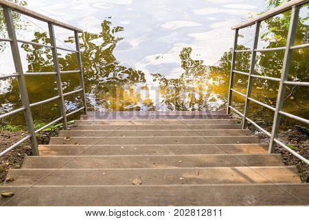 staircase down to the pond. background nature.