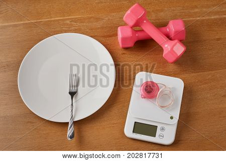 Scales And Empty Plate With Dumbbells