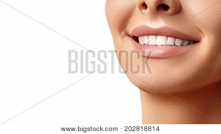 Wide smile of young beautiful woman with perfect healthy white teeth on grey background. Dental whitening ortodont care tooth and wellness. Natural makeup on perfect face.