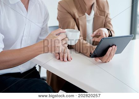 Attractive meeting at nonprofit boardroom group of employees at conference table workers collaborate in discussion