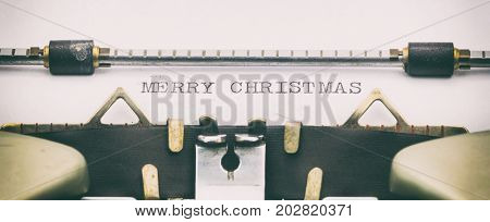 Close-up of MERRY CHRISTMAS on a typewriter sheet