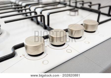 Brand new white gas stove macro closeup