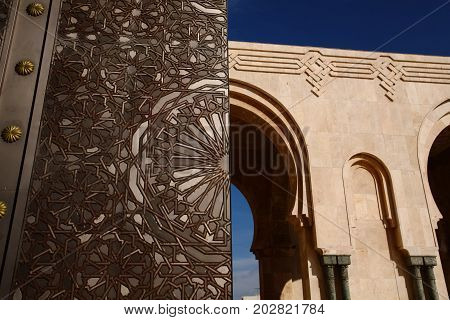 The Big Gate Titanium door of King Hussan II Mosque archwaysBlue day in Casablanca MoroccoAfrica
