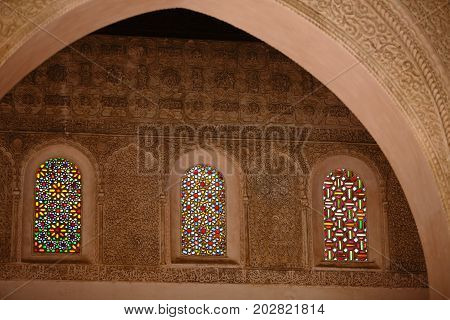 detail decorative of Mosque Old wall decorated with beautiful Stained glassornate moroccan style medieval stained glass window and elaborate plaster carving in Casablanca MoroccoAfrica