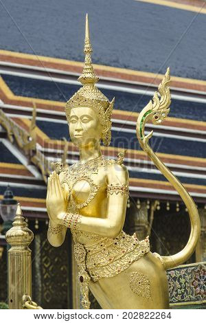 The Goden Kinnaree (Native Thai Style of half angle half bird sculpture) in Temple of The Emerald Buddha (Wat Phra Kaew) BANGKOK THAILAND