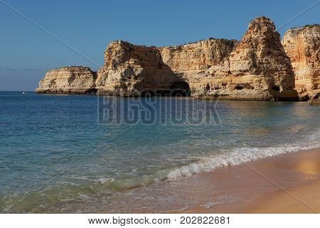 view of sand beaches with rocks washed by atlantic ocean on sunny summer days, Portugal , Algarve