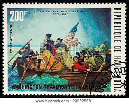 Moscow Russia - September 04 2017: A stamp printed in Upper Volta (Burkina Faso) shows George Washington crossing Delaware River series