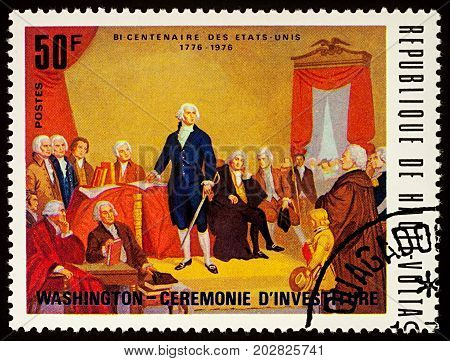 Moscow Russia - September 04 2017: A stamp printed in Upper Volta (Burkina Faso) shows 1st President George Washington - Inauguration Ceremony series