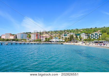 Portoroz, Slovenia - April 17 2017: Portoroz beach and town are a popular tourist and travel destination during all seasons, especially during spring catching first sunny days