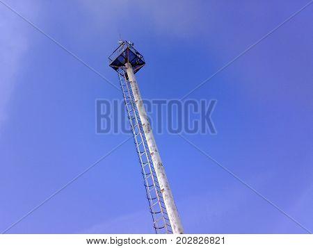 Mast Lighting On A Blue Sky Background. Mast With Lightning Rod And Observation Platform.