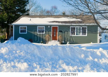 Sixties or seventies bungalows after a winter snowfall.