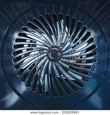 Close-up of metal fan. Inside the furnace