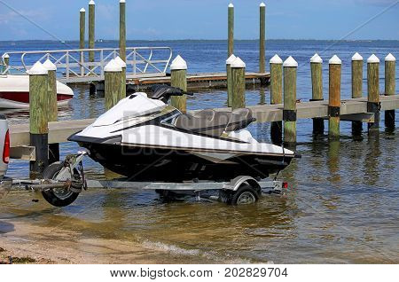 Trailer disembarking watercraft on a sports pier in Tampa Bay