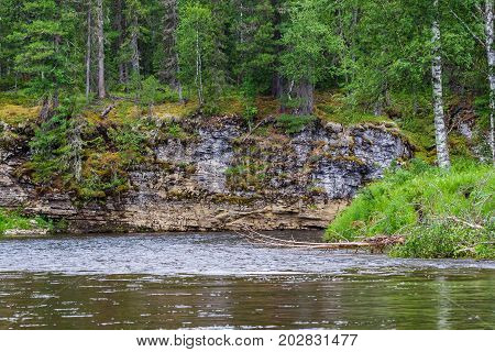 Landscape with water flow and cliffs. Krasnoyarsk territory, Russia