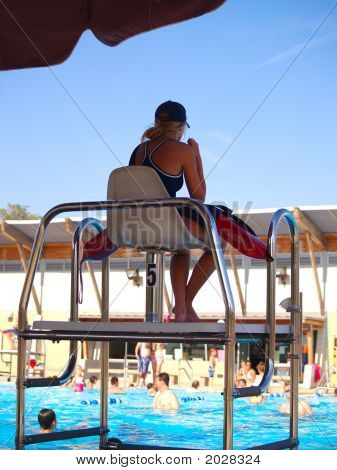 Lifeguard At The Swimming Pool