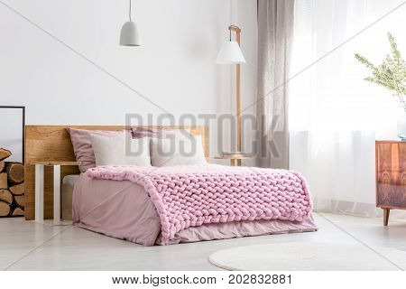 Scandinavian classic bedroom with king-size bed commode and big lamp