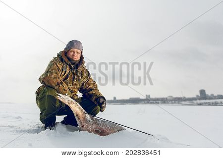 Spearfishing with speargun shot a big fish under the ice of the river Volga near Volgograd area