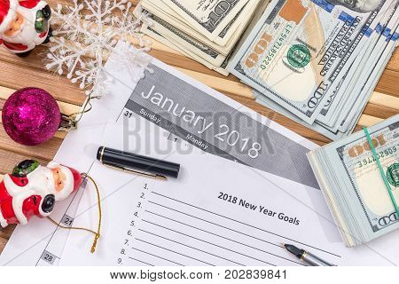 New Year Goals 2018 With Calendar, Cristmas Touy And Dollar Cash