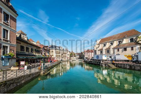 Annecy France - May 25 2016: View of the old city of Annecy with the Palais de l'Isle and Thiou river in Annecy France. Annecy is a commune in the Haute Savoie department of the Rhone-Alpes region in south-eastern France.
