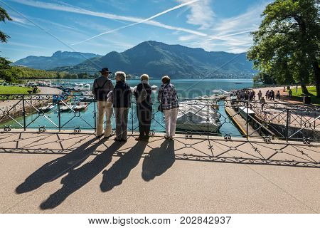 Annecy France - May 25 2016: People on the Bridge of love in Annecy France. Annecy is a commune in the Haute Savoie department of the Rhone-Alpes region in south-eastern France.