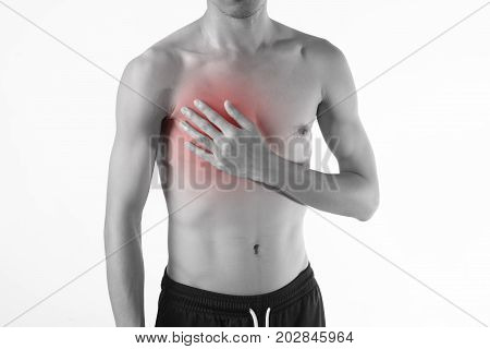Young man chest pain or heart attack on white background.