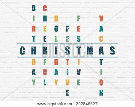 Holiday concept: Painted blue word Christmas in solving Crossword Puzzle