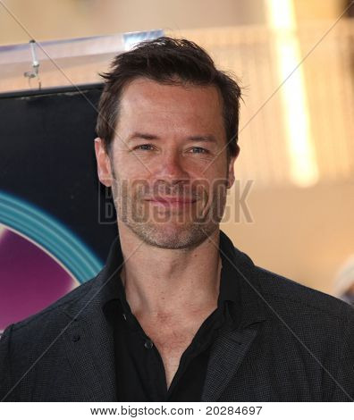 HOLLYWOOD - JAN 13:  Guy Pearce, actor Colin Firth receives star on walk of fame  on January 13, 2011 in Hollywood, CA