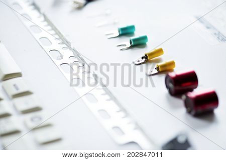 Closeup of various capacitors on white background