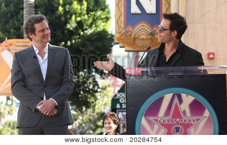 HOLLYWOOD - JAN 13: Colin Firth & Guy Pearce as actor Colin Firth receives his star on walk of fame on January 13, 2011 in Hollywood, CA