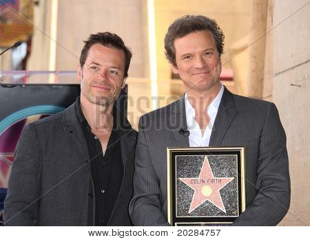 HOLLYWOOD - JAN 13:  Colin Firth & Guy Pearce (L) as actor Colin Firth receives star on walk of fame  on January 13, 2011 in Hollywood, CA.