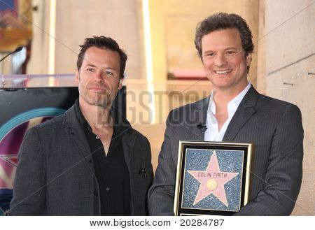 HOLLYWOOD - JAN 13: Colin Firth & Guy Pearce, actor Colin Firth receives star on walk of fame on January 13, 2011 in Hollywood, CA
