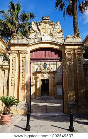 MDINA, MALTA - MARCH 29, 2017 - Entrance archway to the National museum of natural history (formerly the Grand Masters Palace) Mdina Malta Europe, March 29, 2017.