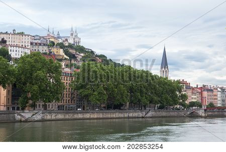 Rhone riverside, Lyon with Notre Dame de Fourviere on horizon