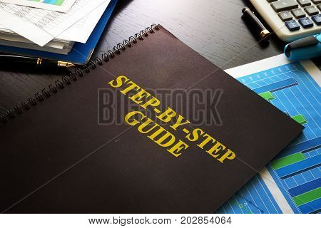 Step-by-Step Guide on a desk. Business knowledge concept.