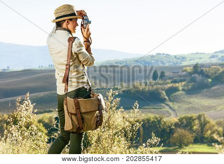Woman Hiker In Tuscany Taking Photo With Retro Photo Camera