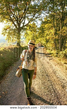 Active Woman Hiker In Hat With Bag On Tuscany Hike