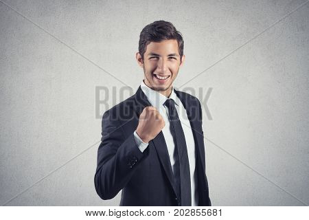 Closeup portrait happy successful business man celebrating success isolated grey wall background. Positive human emotion facial expression. Life perception, achievement