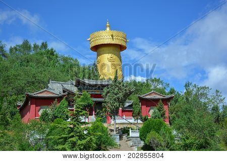 Tibetian monastery and golden buddhist wheel in Shangri-La (Zhongdian) China.