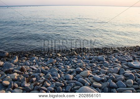 Sea And Pebbles Underwater In A Beach. Pebble Background