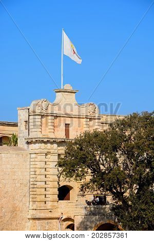 MDINA, MALTA - MARCH 29, 2017 - View of the Town Gate with a horse drawn carriage on the footbridge Mdina Malta Europe, March 29, 2017.