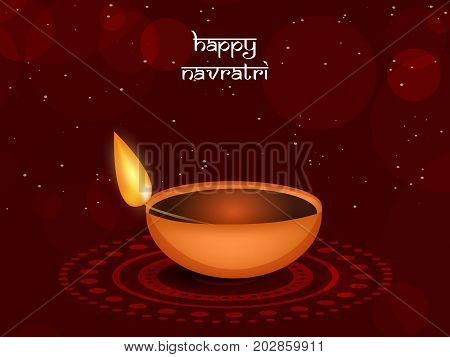 illustration of a lamp with Happy Navratri text on the occasion of hindu festival Navratri
