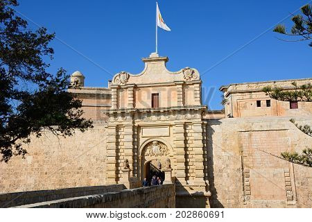 MDINA, MALTA - MARCH 29, 2017 - Footbridge leading to the Town Gate and city centre Mdina Malta Europe, March 29, 2017.